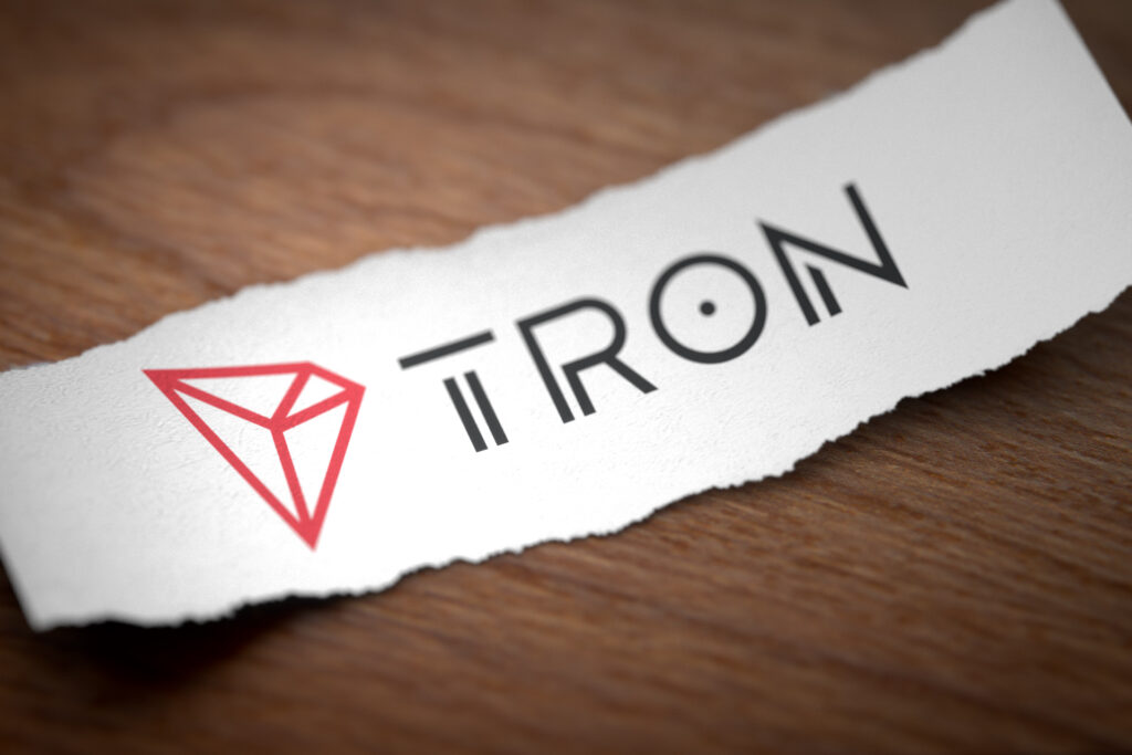 Tron cryptocurrency logo on paper